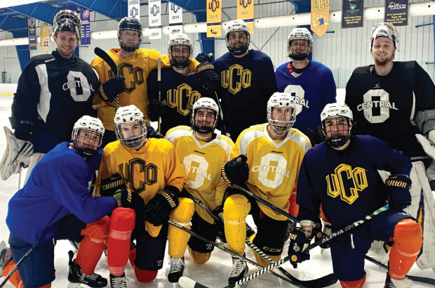 UCO hockey team smiling for group photo