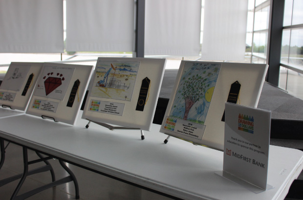 winners of drawing for dollars contest on display